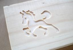 Horse cut into pine